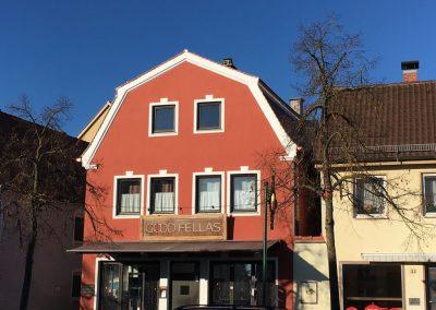 Fassadengestaltung eines Wohn- und Geschäftshauses in Friedberg.